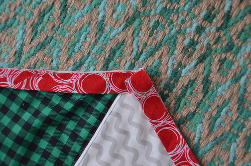 3. Fold the binding down, forming a fold aligned with the corner you're about to turn.inding-21