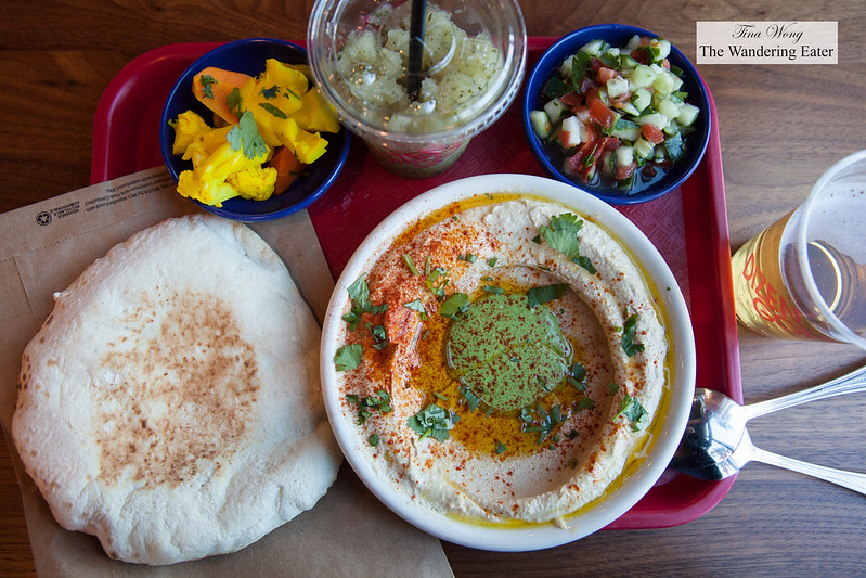Classic Tehina hummus with fresh made pita, chopped cucumber tomato salad and cauliflower pickles