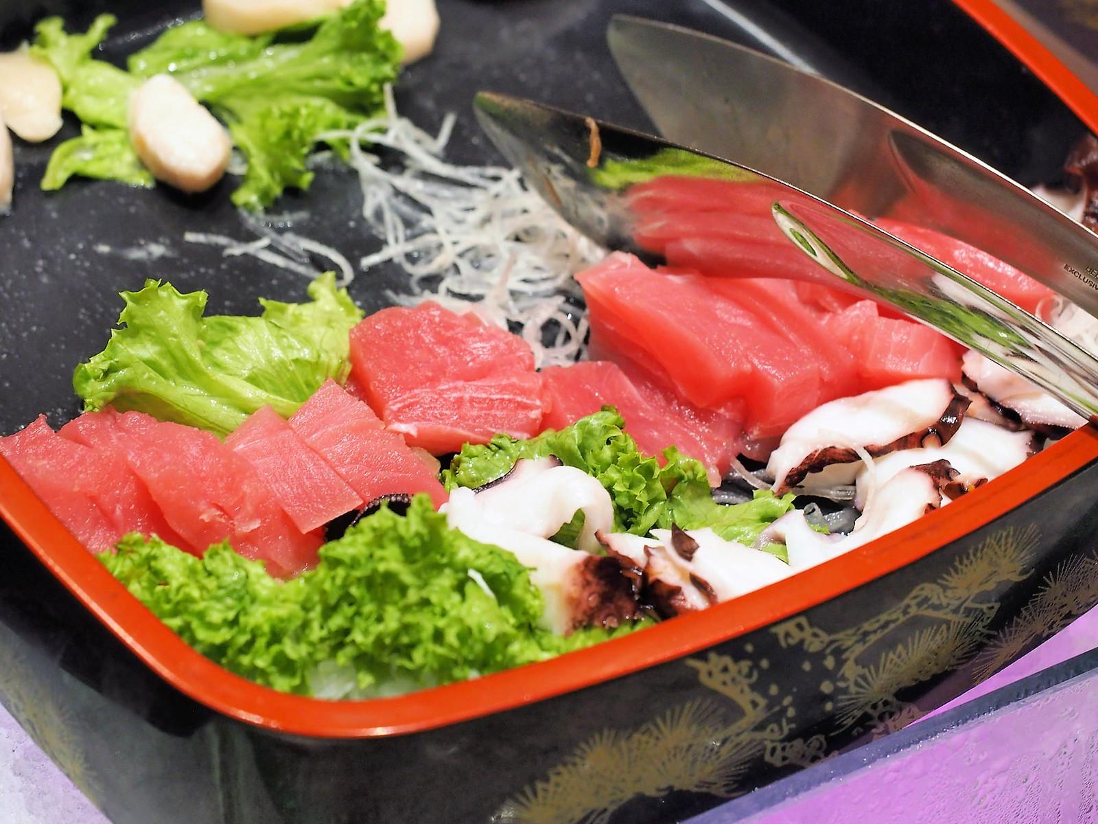Fresh salmon, tuna and cuttlefish shashimi