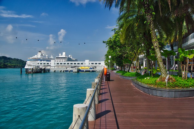 Promenade in front of Vivo City with cruise ship and ferry terminal in Singapore