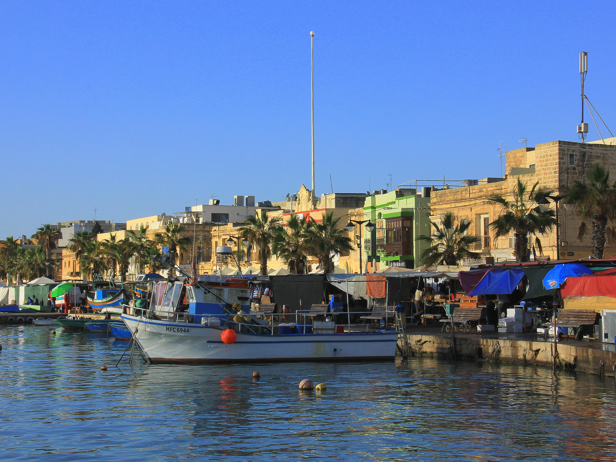 Marsaxlokk is synonymous with colourful fishing boats