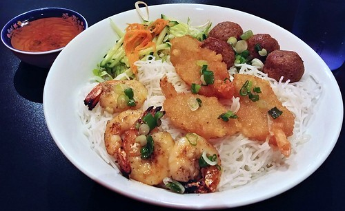 Breaded shrimp, grilled shrimp, beef meatballs, on vermicelli, with fresh vegetables, and fish sauce