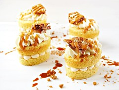 Vanilla Bean Cakes,piped Coconut cream ganache ,filled with salted caramel and topped with chopped hazelnut coffee honeycomb