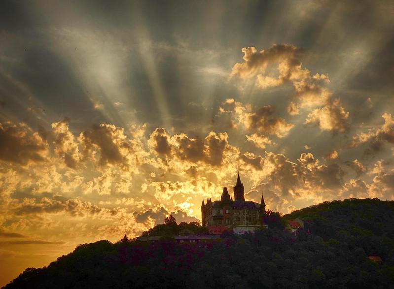Sun rising behind Wernigerode Castle. Credit Tillea