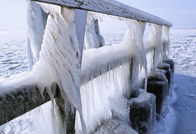 The walkway at Afsluitdijk is covered with ice