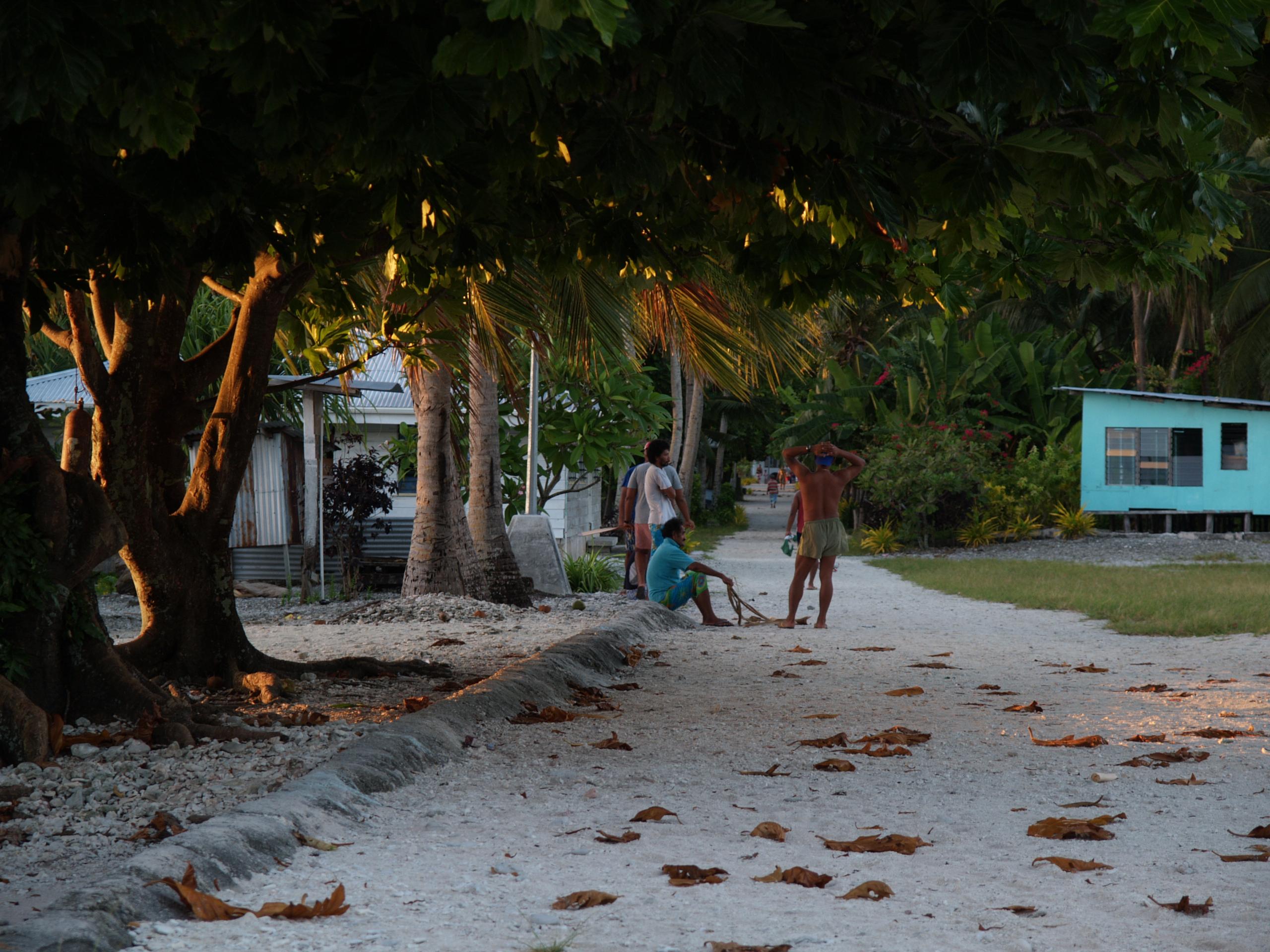 At dawn on a street on Atafu Atoll, Tokelau. Photo taken on July 10, 2007.