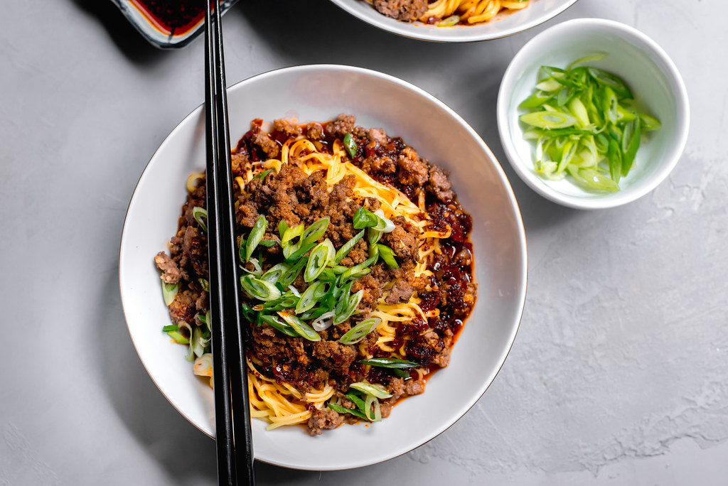 Dan Dan Noodles: Spicy Szechuan Noodles with Chili Oil, ground beef (or ground pork) and topped with green onions.