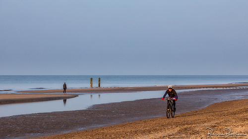 Cycling and jogging on the beach