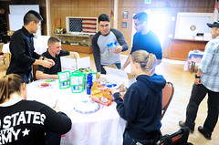 Student volunteers make care packages for troops