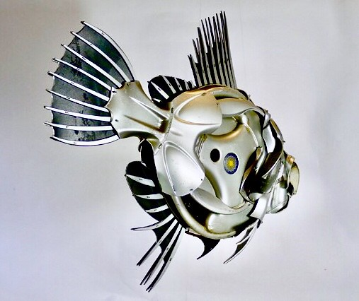 Hubcap fish. Stuck in a plastic bag in my studio. Save him!! #johndory #fishing #fish #recycled #upcycled #sculpture #art #hubcapcreatures