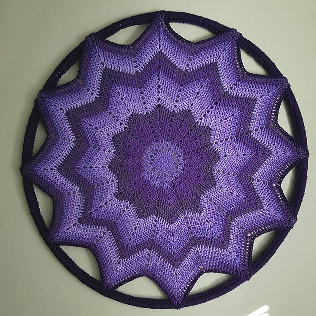finished this piece yesterday! 💜 I used a skein of Caron Big Cakes in the grape jelly color way and crocheted a round ripple until it was large enough to stretch onto a hula hoop. It's for my oldest who had been asking for something mandala-l