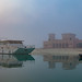 Boat moored near Zayed Heritage Centre on foggy morning by Jhopne
