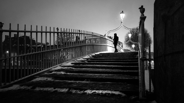 Snowy hapenny bridge dublin ireland black and white street photography