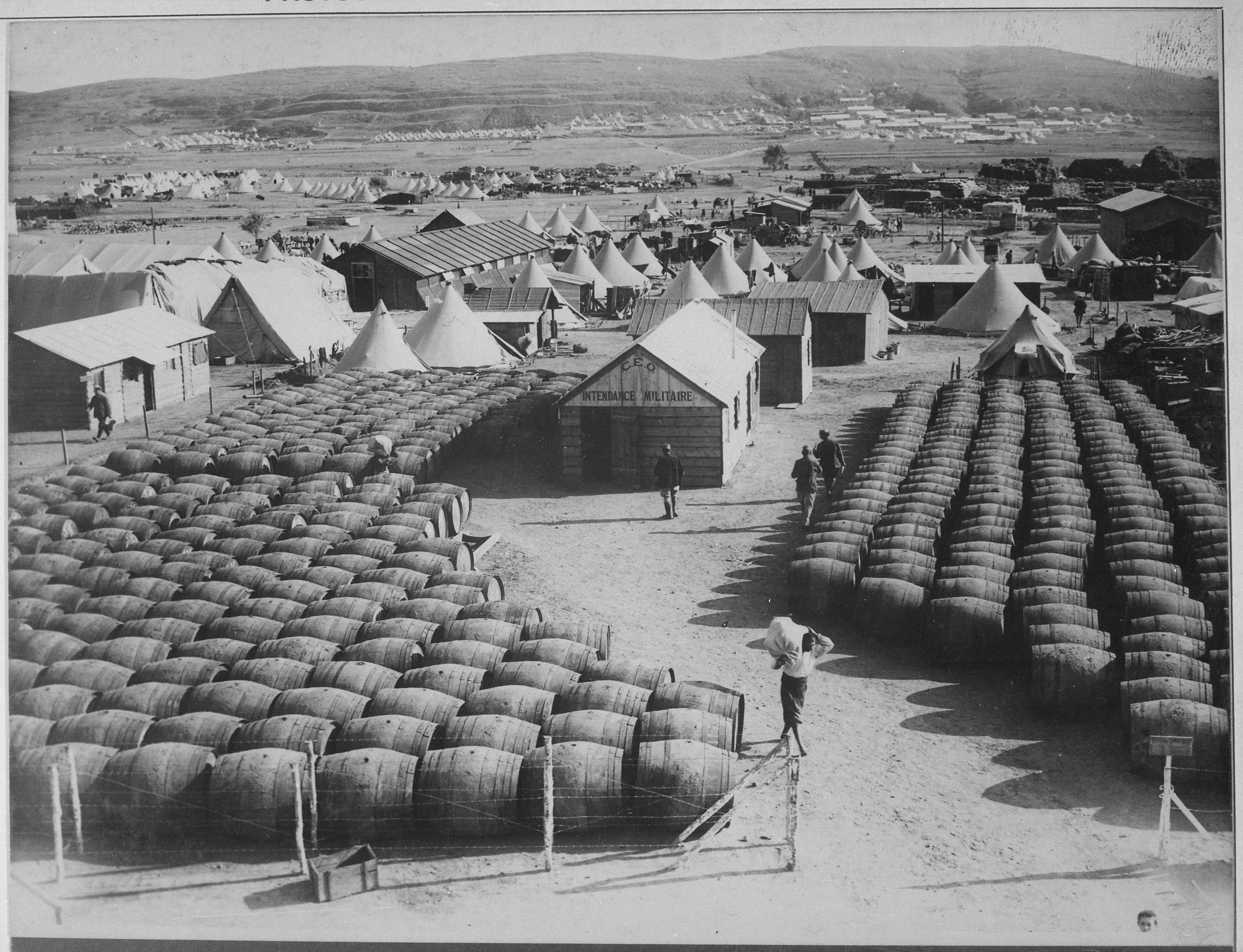 View of Moudros during the Dardanelles Campaign, better known as the Gallipoli Campaign that took place between February 17, 1915, and January 9 1916 , with a French military wine store in the foreground and a hospital in the background