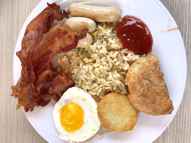 Breakfast: Fried rice, bacon, eggs, hash brown, curry puffs, spring rolls
