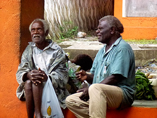 Two old men sitting talking in the market place in Lenakel, Tanna in Vanuatu.