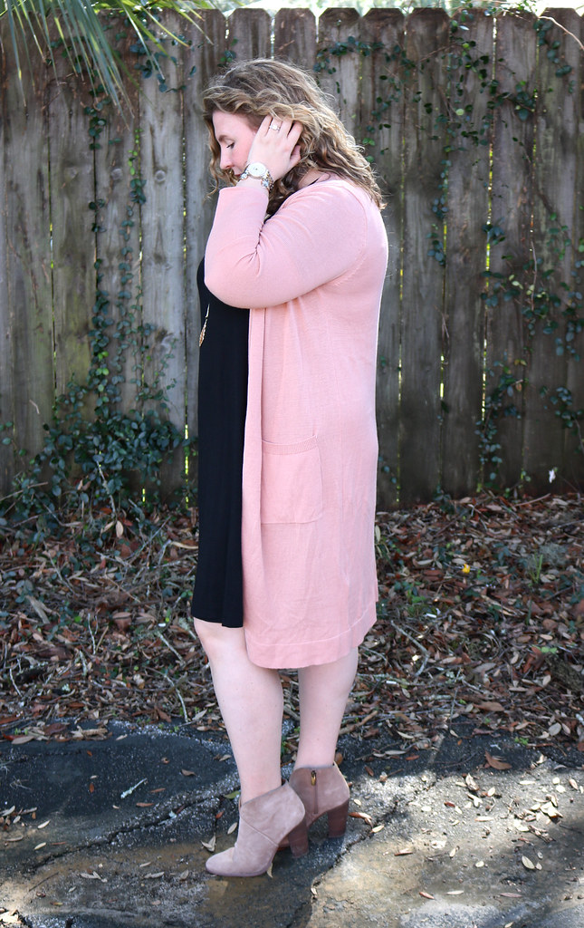 long pink cardigan, black swing dress, mushroom booties 7