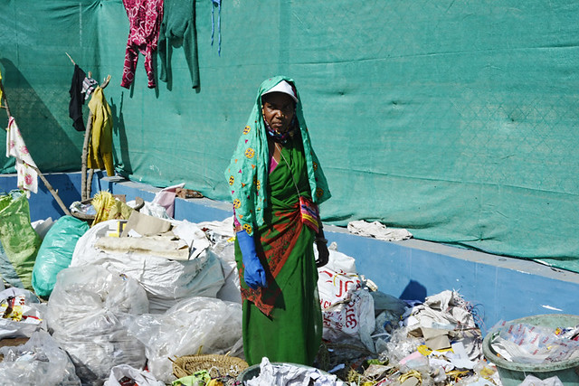 An SHG worker segregates garbage at Deviganj SLRM centre.