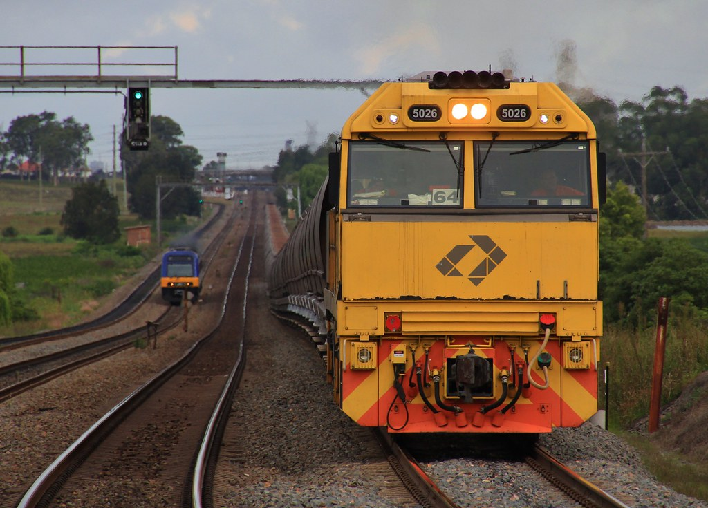 5026 pulls while 5022 pushes at the rear of BW987H Aurizon coal by bukk05