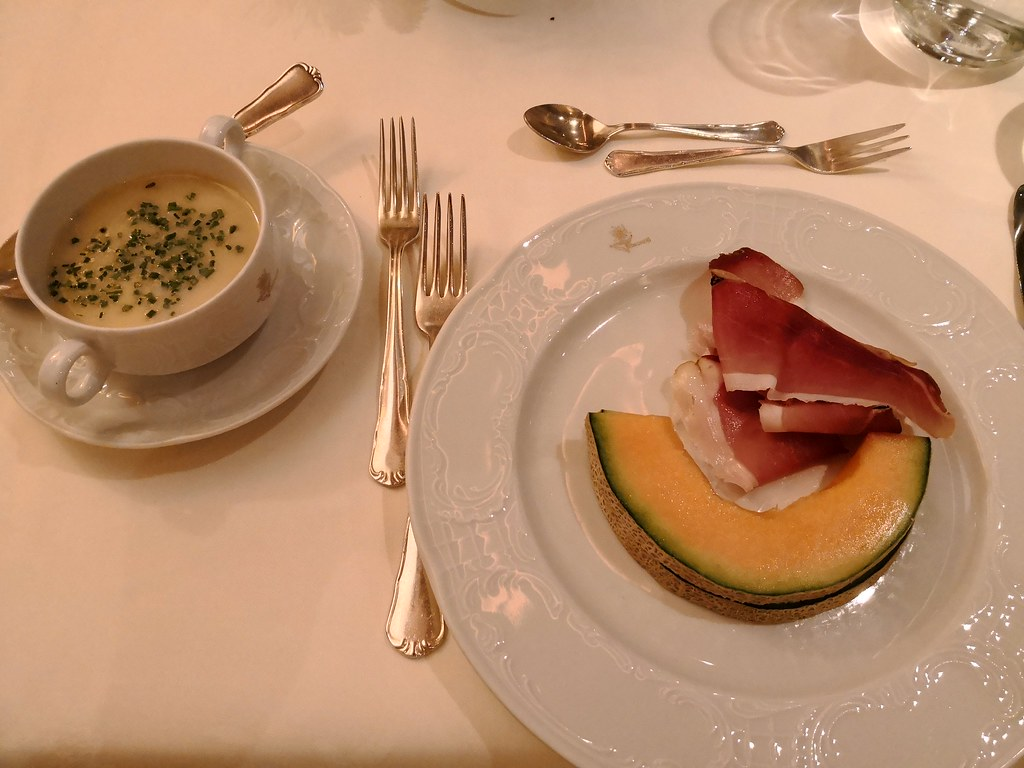 Soup, speck and cantaloupe