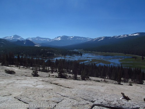 Views down on a (very flooded) Tuolumne Meadows. Peaks are (L-R) Mt. Dana, Lembert Dome (below), Mt. Gibbs, Mammoth Peak, and the shoulder of another mountain. Yosemite National Park, California
