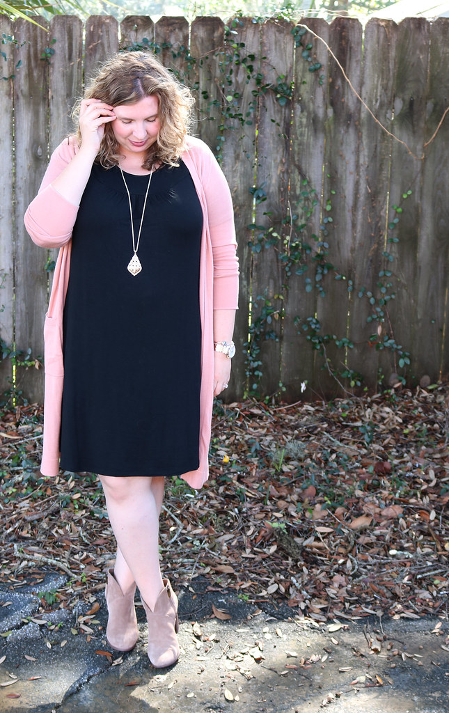 long pink cardigan, black swing dress, mushroom booties 6