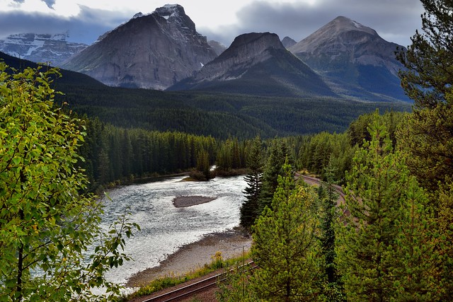 Beautiful Mountain Peaks Caught in the Late Afternoon Sunlight as a Backdrop for Morant's Curve (Banff National Park)
