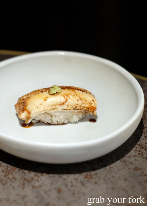 Sea eel anago nigiri sushi glazed with Chef Ryuichi Yoshii's 25-year-old soy sauce, part of our omakase by Chef Ryuichi Yoshii at Fujisaki by Lotus at Barangaroo in Sydney