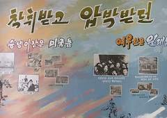 North Korean propaganda poster in a primary school depicting the japanese killings during the war, South Pyongan Province, Chongsan-ri Cooperative Farm, North Korea