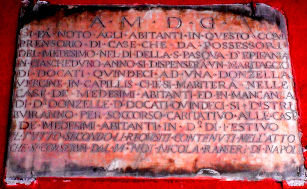 Marble plaque (18th century) at Vico delle Rose a San Potito in Naples