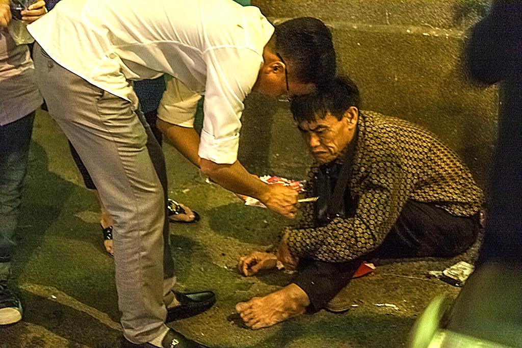 Man begging at gate of Vinh Nghiem Pagoda--Saigon
