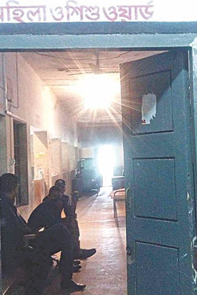 Policemen stationed at the women and children ward of Rangamati Sadar Hospital on January 28. From thedailystar.net