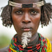 Dassanech woman portrait with beaded necklaces and feather, Omo valley, Omorate, Ethiopia by Eric Lafforgue