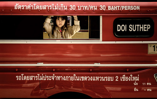 thai girl candid portrait streetshot streetphotography songthaew สองแถว rotsidaeng songthaeo รถสีแดง coveredpickuptruck bus taxi transportation red passengervehicle chiangmai chiangmaithailand southeastasia siam asian holdingon riding eyecontact bangs bracelets openwindow cuffs 30baht metal metallic fender child youth nikond5100 tamron18270 photoshopbyfehlfarben thanksbinexo