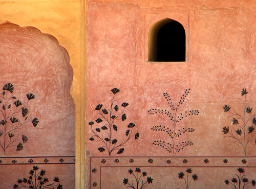 Subtly painted wall at the Amber Fort and Palace near Jaipur in India