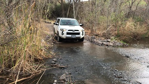 Gila Box Riverview - Truck going through bonita creek