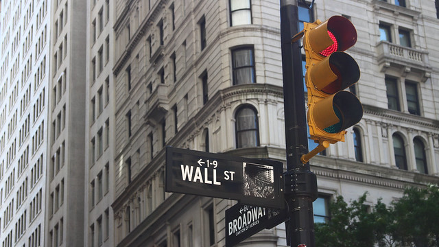 Wall Street sign next to traffic light in New York