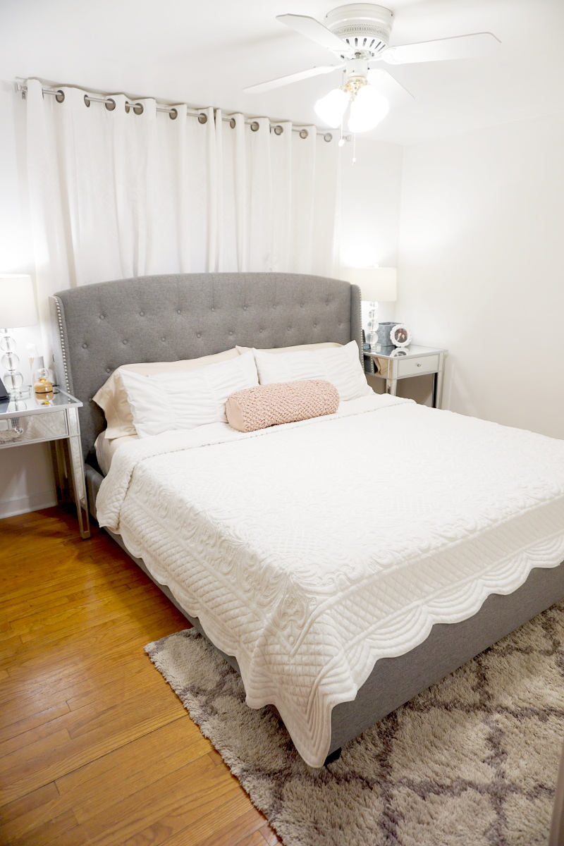 Gray-headboard-white-quilted-sheets-pink-bolster-7