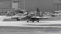 Growler Landing In Front of Old Prop Planes