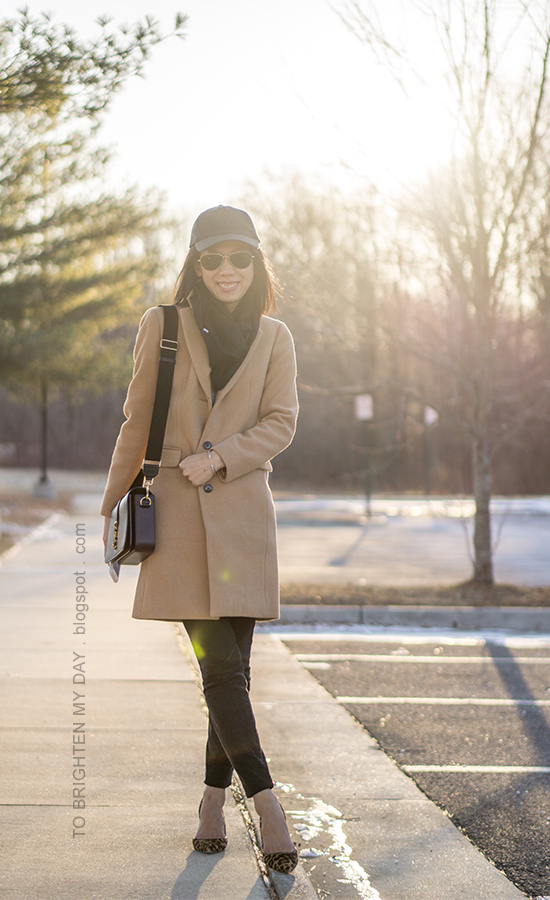 gray baseball cap, black infinity scarf, camel wool coat, black shoulder bag, black pants, leopard pumps