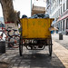 Chinese Trash Collection Wagon Parked on the Sidewalk During Workday in Xian, March 2018