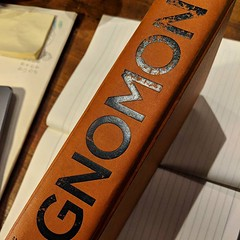 Very big, very orange and very good. I will miss reading @harkaway 's Gnomon - and it's strangely comforting weight in my bag. Thoughtful, surreal in some places and familiar in others. Really strong points about technology and society.