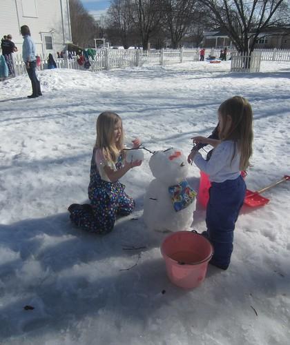constructing a snowman