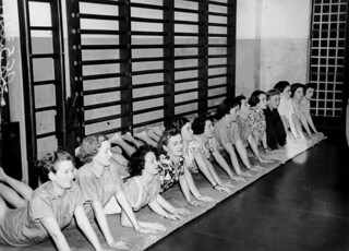Ladies are all smiles as they perform their exercises at the Women's Australian Air Force gymnasium, Brisbane, 1942