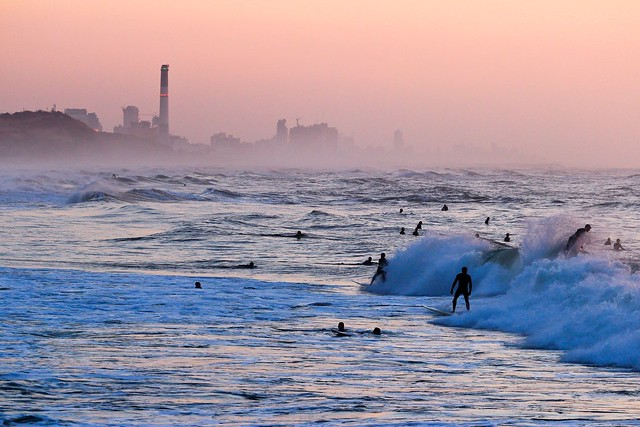 Surfing at sunset -Tel-Aviv beach