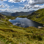 13. August 2017 - 13:36 - Heading down from a day on the Carneddau the inviting waters of Ffynnon Llugwy Reservoir look very enticing whilst descending the stony path. Snowdonia, North Wales.