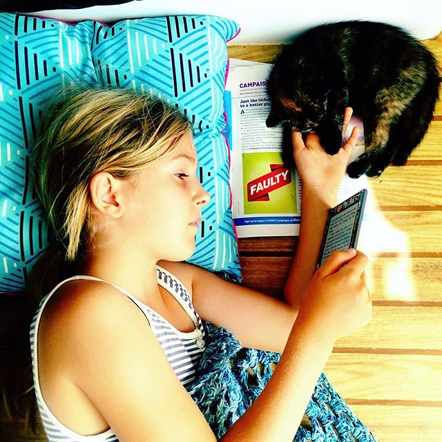 021/365 • a girl, a kitten, a kindle and a cushion • . #yamba #whitingbeach #10yo #love #perfection #reading #catsofinstagram #boatcat #northernnsw #visitnsw #abcmyphoto #bellalunaboat #cruising #Summer2018 #eastcoastaustralia #clarencerivernsw