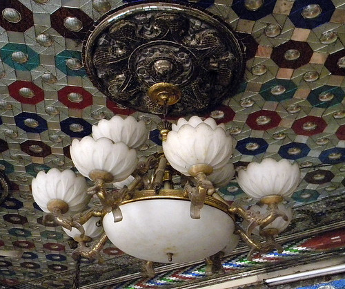 Lighting fixture in a glass mosaic ceiling in a Delhi temple, India