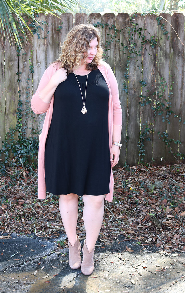 long pink cardigan, black swing dress, mushroom booties 1