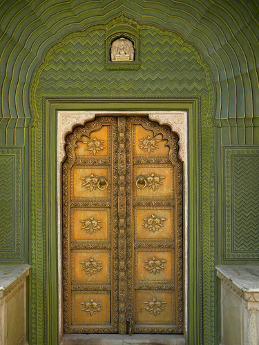 Decorative painted door and walls at Hara Mahal, the Palace of the Winds in Jaipur India